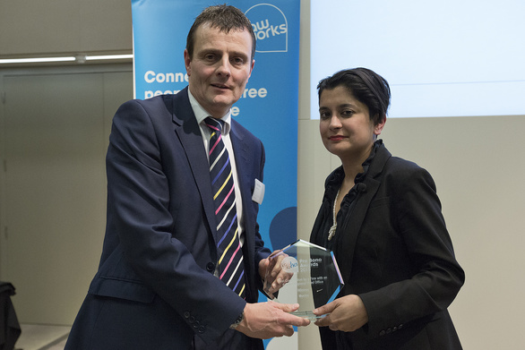 Keith Bishop receiving the Best Contribution by a Regional Law Firm on behalf of Muckle given by Shami Chakrabarti.