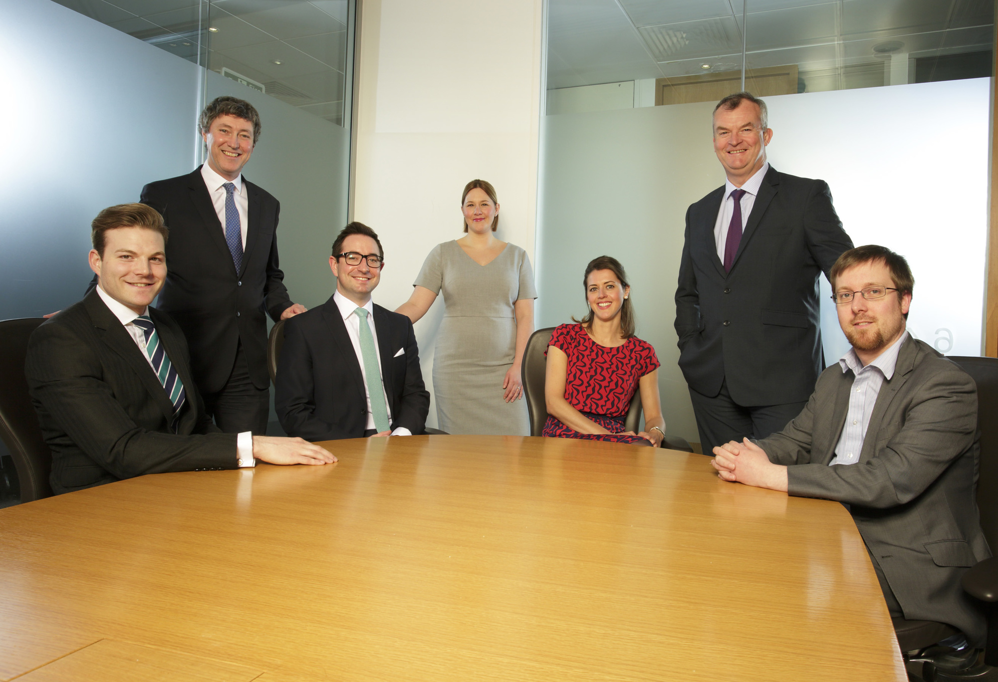 Partners Andrew Davison, Gail Bennett and Jonathan Combe (standing) with the newly promoted Associates.