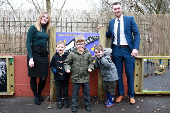 Sam and Anthony meet children at the activity board Muckle LLP donated to Hadrian School
