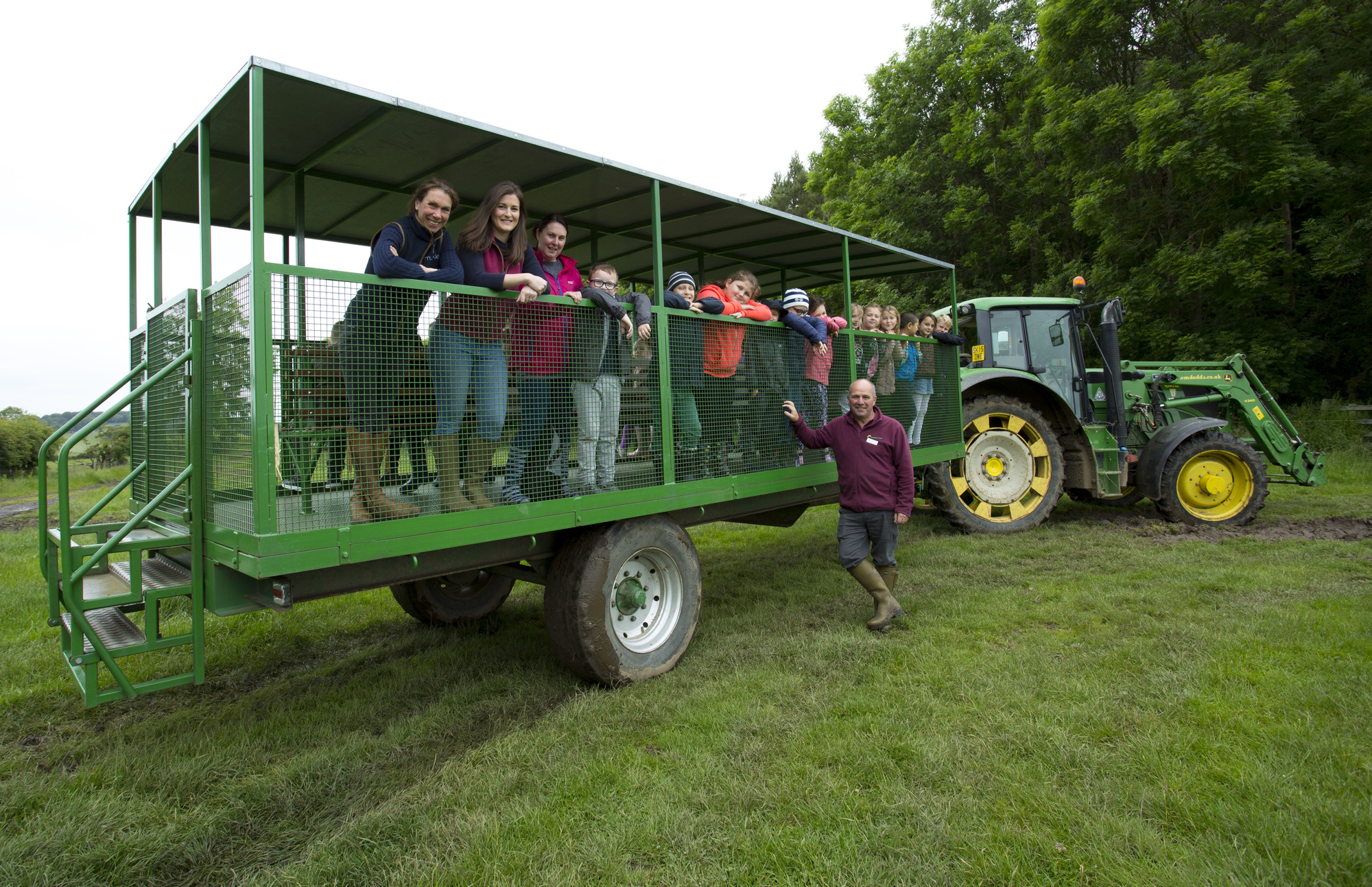 Farmyard fun: Teachers and students from St Lawrence RC Primary School, Byker, with David Thompson (The Country Trust) and Beth Thompson and Elizabeth Earle (Muckle LLP) at Broxfield Farm.