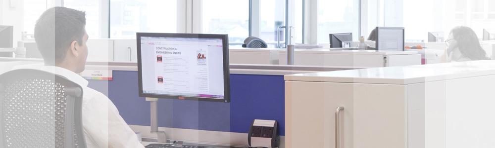 Muckle worker at desk